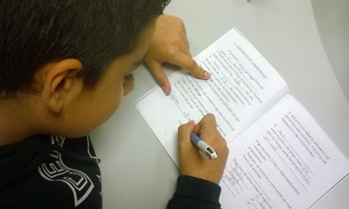 A photographer signing the contract